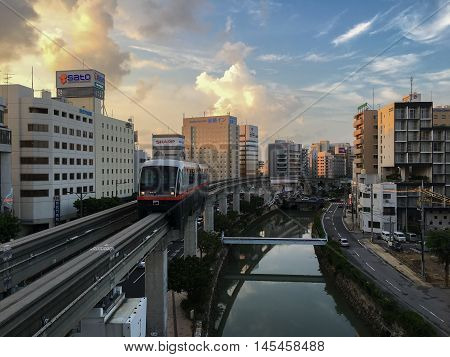 Okinawa Monorail (Yui-Rail) is an only rail transport in Naha City, Okinawa, Japan. It's approaching Asahibashi station in the evening of  July 25, 2016.