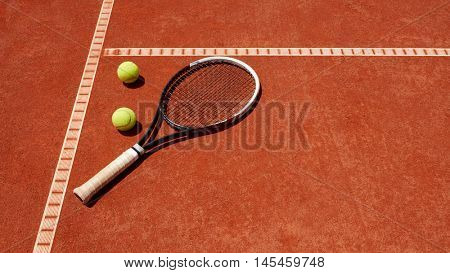 Close up of tennis balls and racket on dross at tennis court