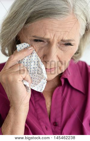 Portrait of an sad elderly woman close up