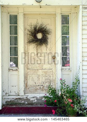 Decorated white door on  an abandoned house