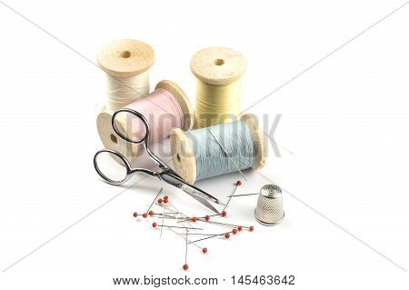 Threads in pastel Colors and sewing accessories