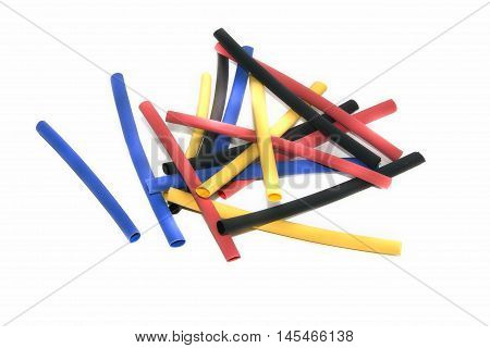 Colour tubules of a stick are scattered on a white background