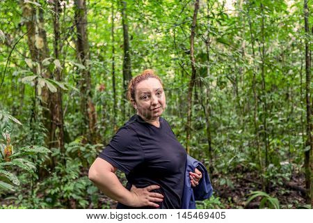 Young Caucasian Woman With Rain Coat Traveling Along Amazonian Jungle Cuyabeno National Park South America