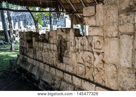 Mexiko yucatan at Chichen Itza ruins wall