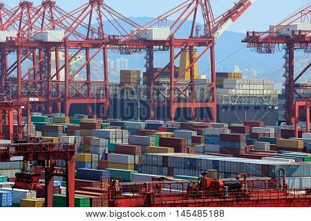 Closeup Industrial port with containers Shanghai Yangshan deepwater port is a deep water port for container ships in Hangzhou Bay south of Shanghai China.