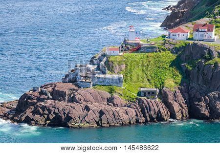Sunny summer day over the coastline and cliffs of National Historic Site of Canada, Fort Amherst in St John's Newfoundland, Canada.