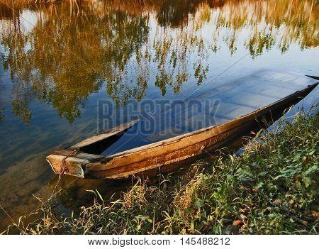 Sunken boat in river. River Jadar in West Serbia.