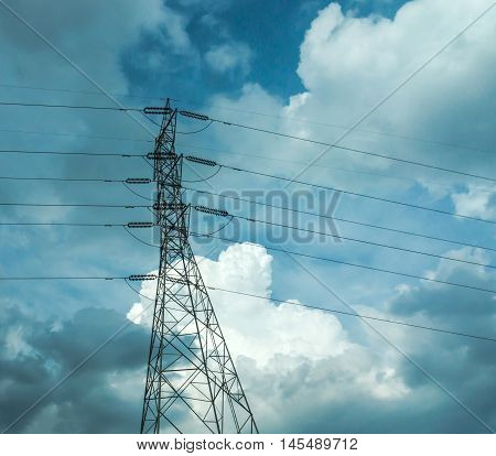 Electrical poles of high voltage in white cloud and blue sky / electric pole power lines and wires with blue sky / high voltage equipment on an electric pole / High-voltage sky background.