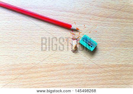Pencil, sharpener, closeup top view Colored pencils on a wooden board