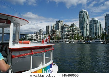 Tourists traveling on a water taxi in Vancouver, Canada. Photo taken July, 2016.