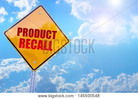 product recall word on yellow traffic sign blue sky background