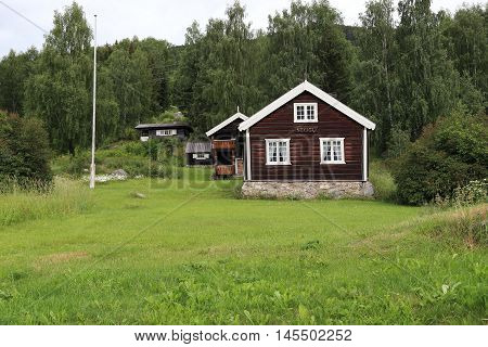 TORPO, NORWAY - JULY 2, 2016: There are houses and homestead land in the highland countryside.