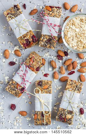 Homemade granola energy bars with figs oatmeal almond dry cranberry chia and sunflower seeds healthy snack top view