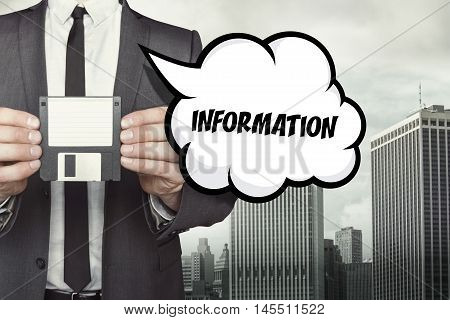 Information text on speech bubble with businessman holding diskette