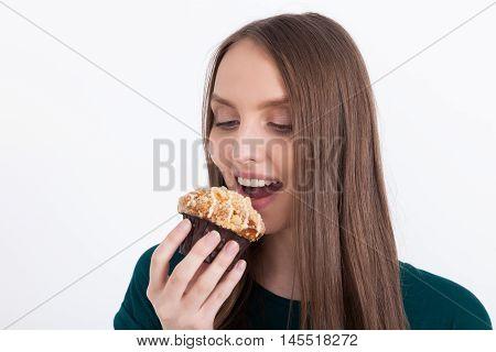 Girl Biting Cupcake