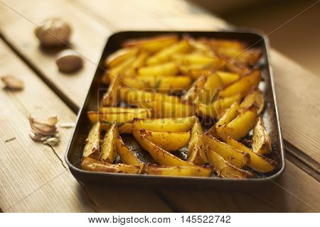 Baked potato wedges with garlic and rosemary