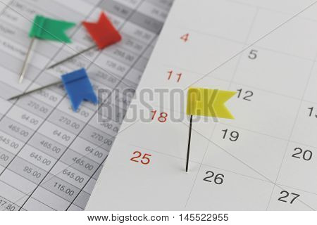 Yellow Pins to Wildcats on the calendar beside the number of twenty five in business concept time and date.