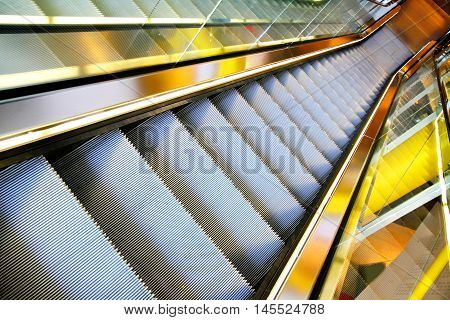 A Photo of a modern escalator. .