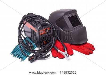 Inverter welding machine, isolated on a white background, welding mask, leather gloves, welding electrodes, high-voltage wires with clips, set of accessories for arc welding