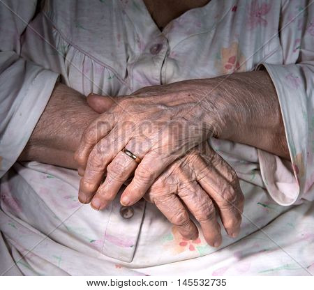 Close up of old womans wrinkled hands