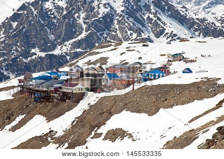 DOMBAY RUSSIA - May 03.2015: Small village with cafes. Recreational accommodation for skiers on the mountain Mussa-Achitara