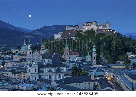Aerial view of historic city of Salzburg with Hohensalzburg Fortress by night, Salzburger Land, Austria