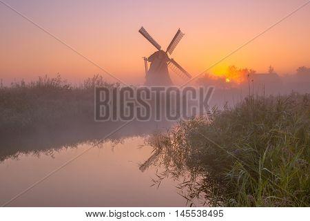 Historic Windmill Along A River