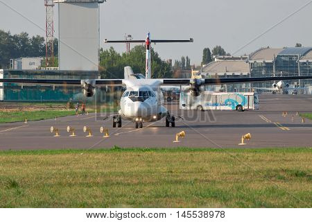 Kiev Ukraine - July 27 2012: ATR-72 regional plane front view at the airport taxiing to runway