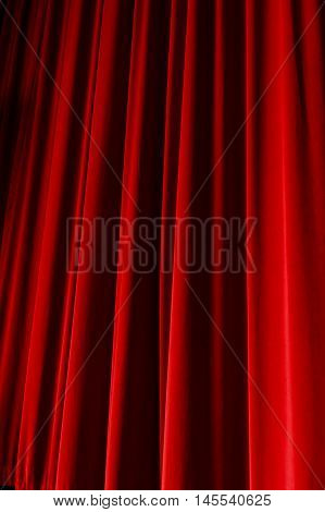 Red drop curtain hanging down on a stage