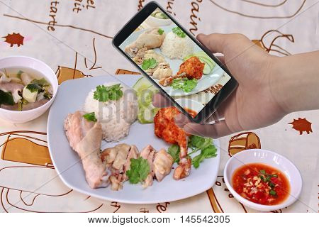 Take photo a dish of streamed oily rice and streamed chicken as