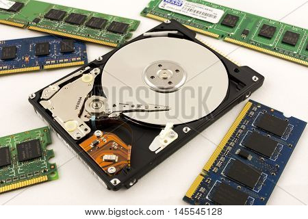 Laptop HDD on the white background and RAM memory. Disassembled hard disk (without top cover). inside view of notebook hard disk.