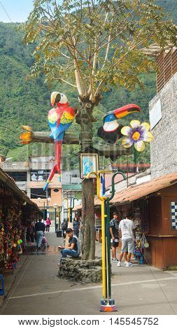 Banos de Agua Santa, Tungurahua / Ecuador - September 2 2016: Bird sculptures in the Pasaje Artesanal in the downtown of the city. Banos is located on the northern foothills of the Tungurahua volcano