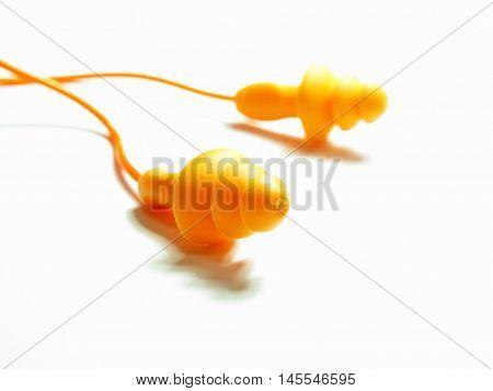 orange isolated pair earplug on white background