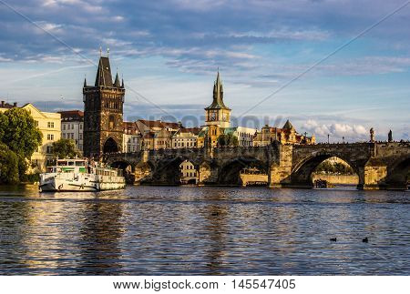 Charles bridge in Prague at sunset. Concept of travel