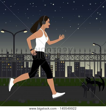 running girl with headphones in sportswear on the background of the city at night. In the background there are street lights house stars in the sky.