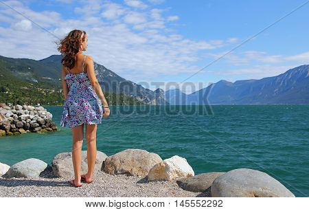 Girl at the beach of garda lake windy weather