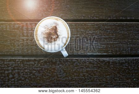 Top View Of Hot Coffee In The Morning On Wood Table ,selective Focus,filtered Image,light And Flare