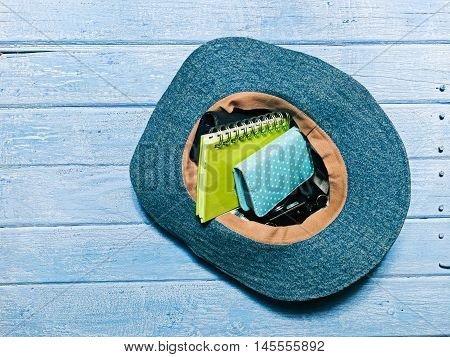 Set of modern girl: female accessories inside the hat the planked footway. Flat lay
