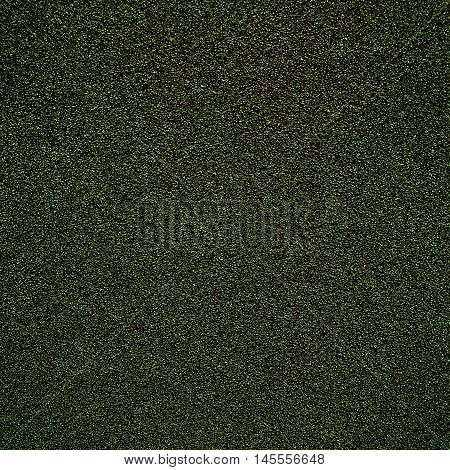 Colorful textured background - Sandpaper texture for Backdrop. Abstract rough sandpaper sheet close up green color