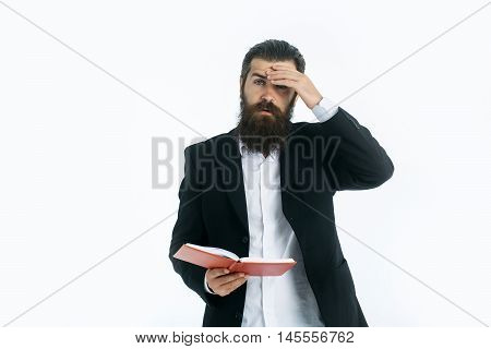 young handsome bearded man scientist or professor businessman with long beard in jacket holding red book or notepaper isolated on white background