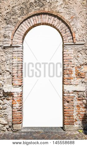 Old wooden door with upper railing and brick archway suitable as a frame.