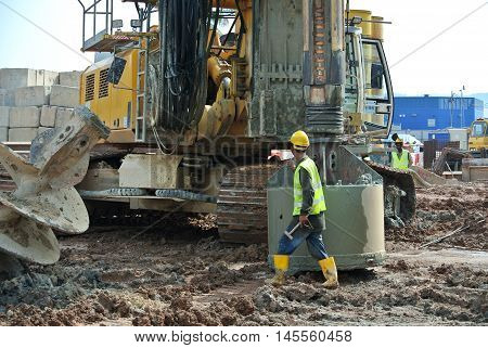 MALACCA, MALAYSIA -MARCH 12, 2015: Bore pile rig machine at the construction site in Malacca, Malaysia. The machine used to driven pile for building foundation work.