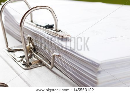 Close up of a business file folder with documents storage of contracts. selective focus.