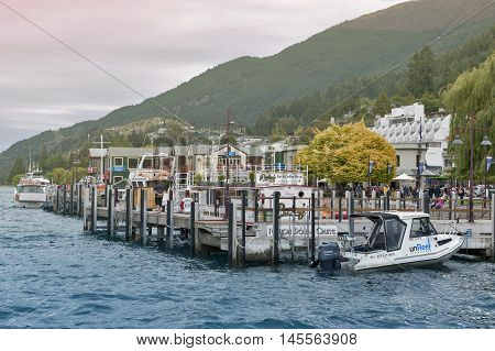 Queenstown New Zealand - March 2016: Boat piers at Queenstown lakefront by Lake Wakatipu New Zealand