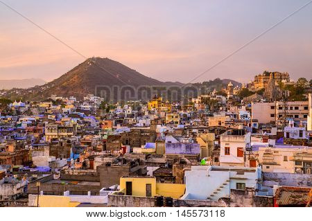 A view over rooftops in central Udaipur in the morning. The Machla Hills can be seen in the distant.