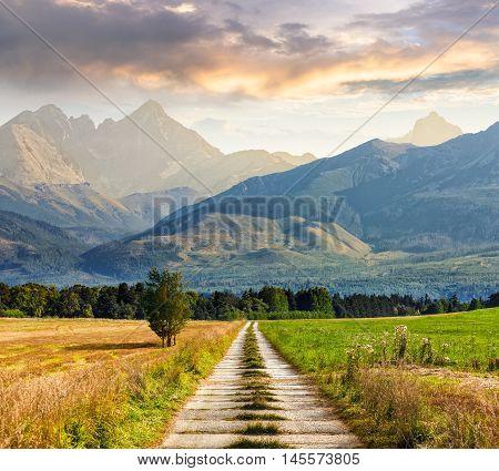 Rural Fields Near The High Mountains