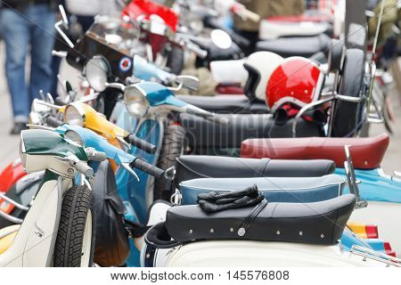 STOCKHOLM SWEDEN - SEPTEMBER 03 2016: Many retro vespa scooters only one scooter in focus before the start of the Mods vs Rockers event at the Saint Eriks bridge Stockholm Sweden September 03 2016