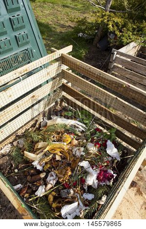 Image of compost bins in a garden.