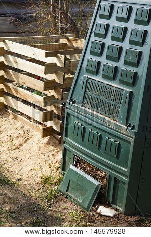 Compost bin in a  sunny autumn garden