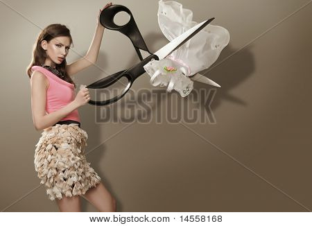 A young blonde with huge scissors